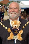 Councillor Julian Barge (BSTC Mayor) gives Bradley Bear a ride on the Mayoral train