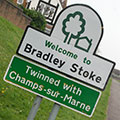 Road sign saying 'Welcome to Bradley Stoke - Twinned with Champs-sur-Marne'