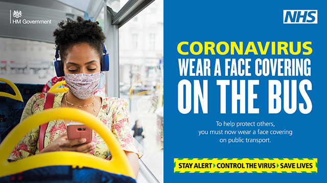 "Coronavirus poster which says ""Wear a face covering on the bus"""